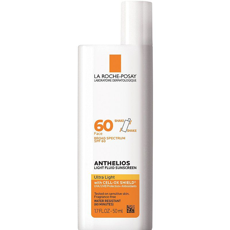 Sunscreen in white and orange bottle