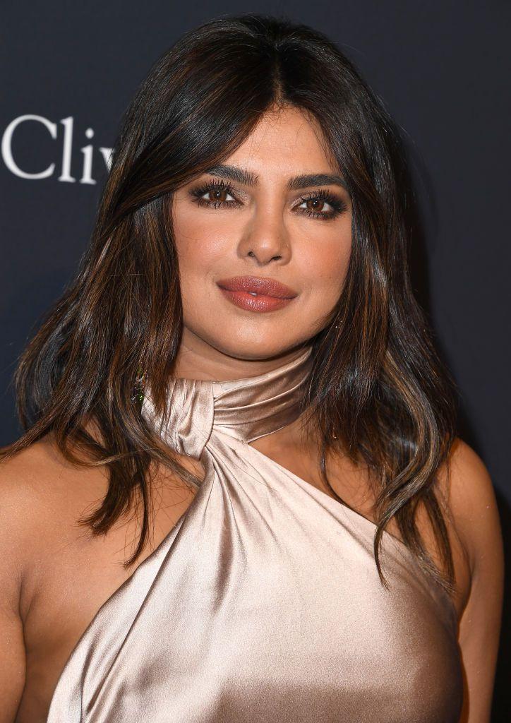 Priyanka Chopra with brown hair and chocker dress