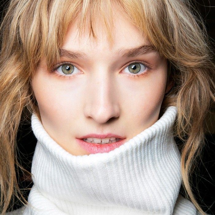 Blonde woman in white turtleneck