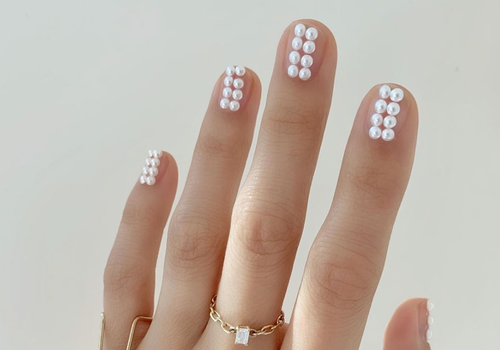 manicure with nude nails and pearl attachments