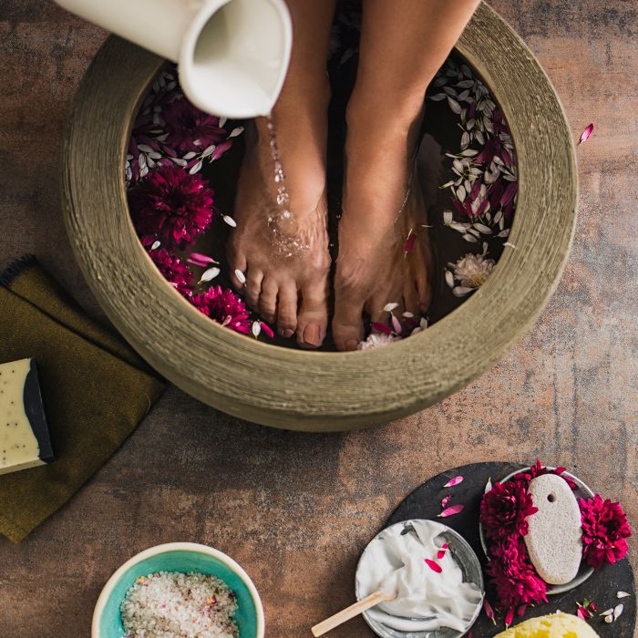 Best Foot Soaks: Woman with wooden foot bath