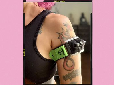 Writer wearing black and green B Strong Blood Flow Restrictor Band on her arm.