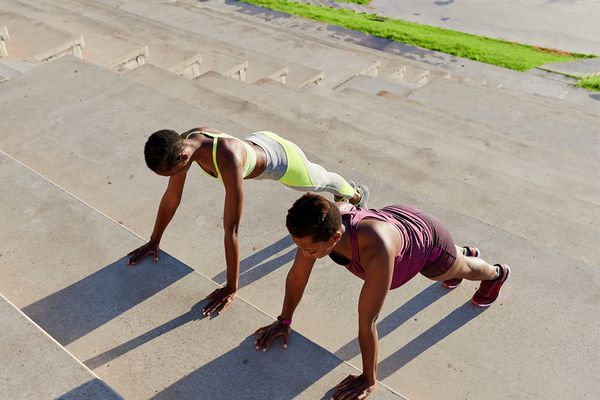 two people doing workout outside