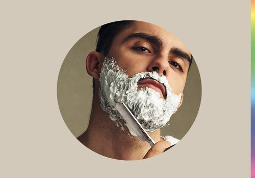 Man shaves with a straight razor