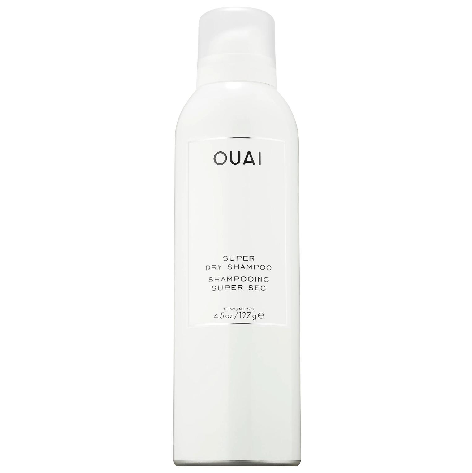 ouai super dry shampoo in an all white aerosol can