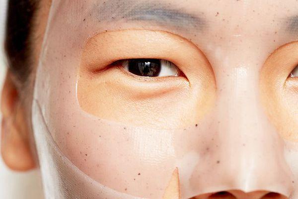 Woman wearing sheet mask