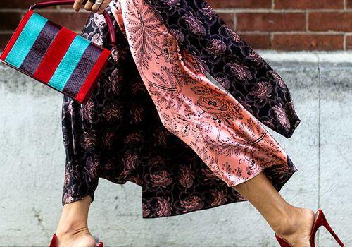 A woman walking in heels