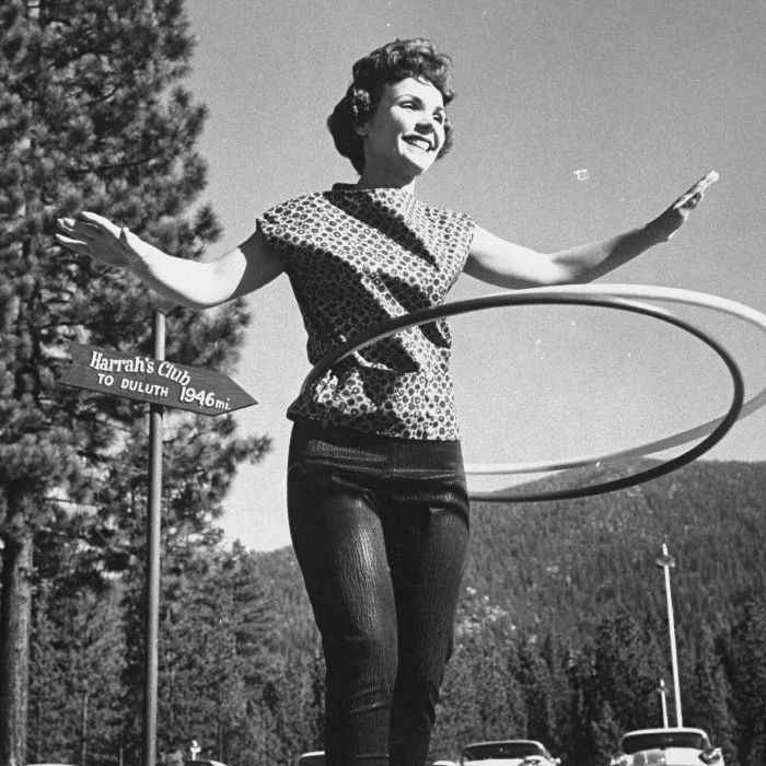 A woman from the 1950's and 1960;s hula hooping