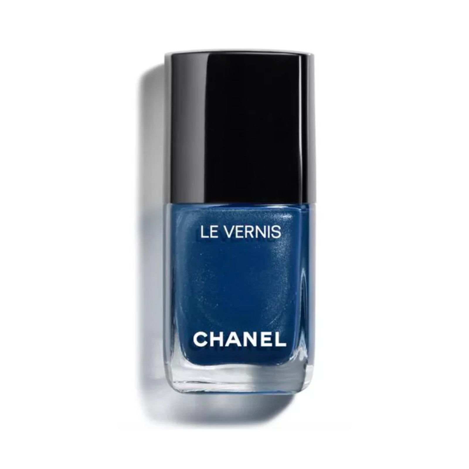 Bottle of dark blue nail polish with a black top.