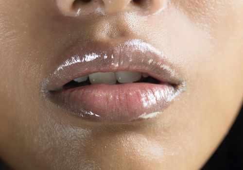 close up of woman with oil on her lips