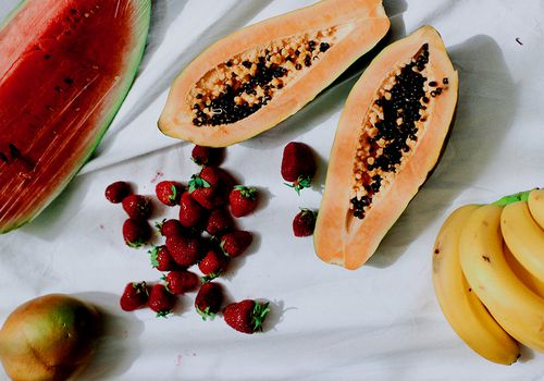 fruit on white table cloth