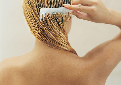 Woman Combing Wet Hair
