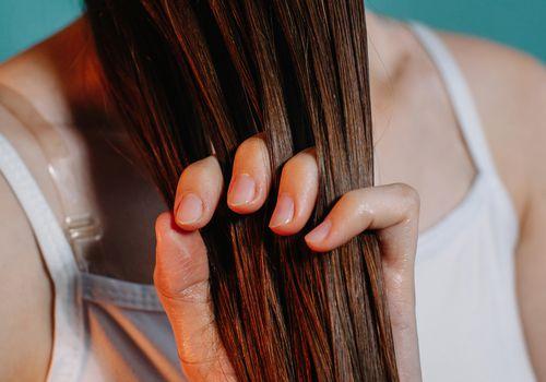 woman applying a hair mask