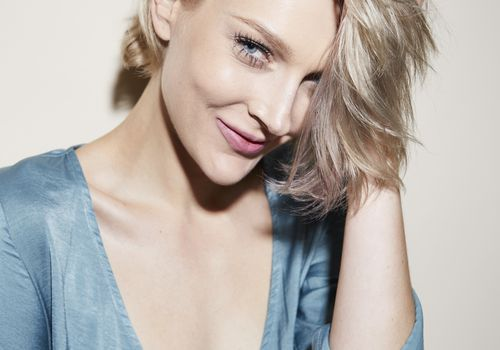 Portrait of beautiful blond woman wearing evening dress