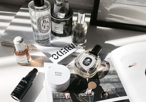skincare bottles and perfume on dresser table