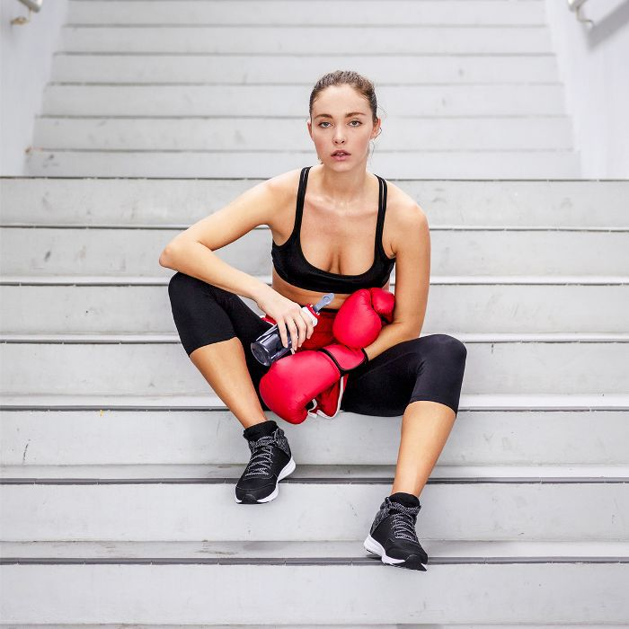 how to overcome anxiety with boxing: woman with boxing gloves