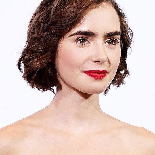 Lily Collins short side-parted hair on the red carpet