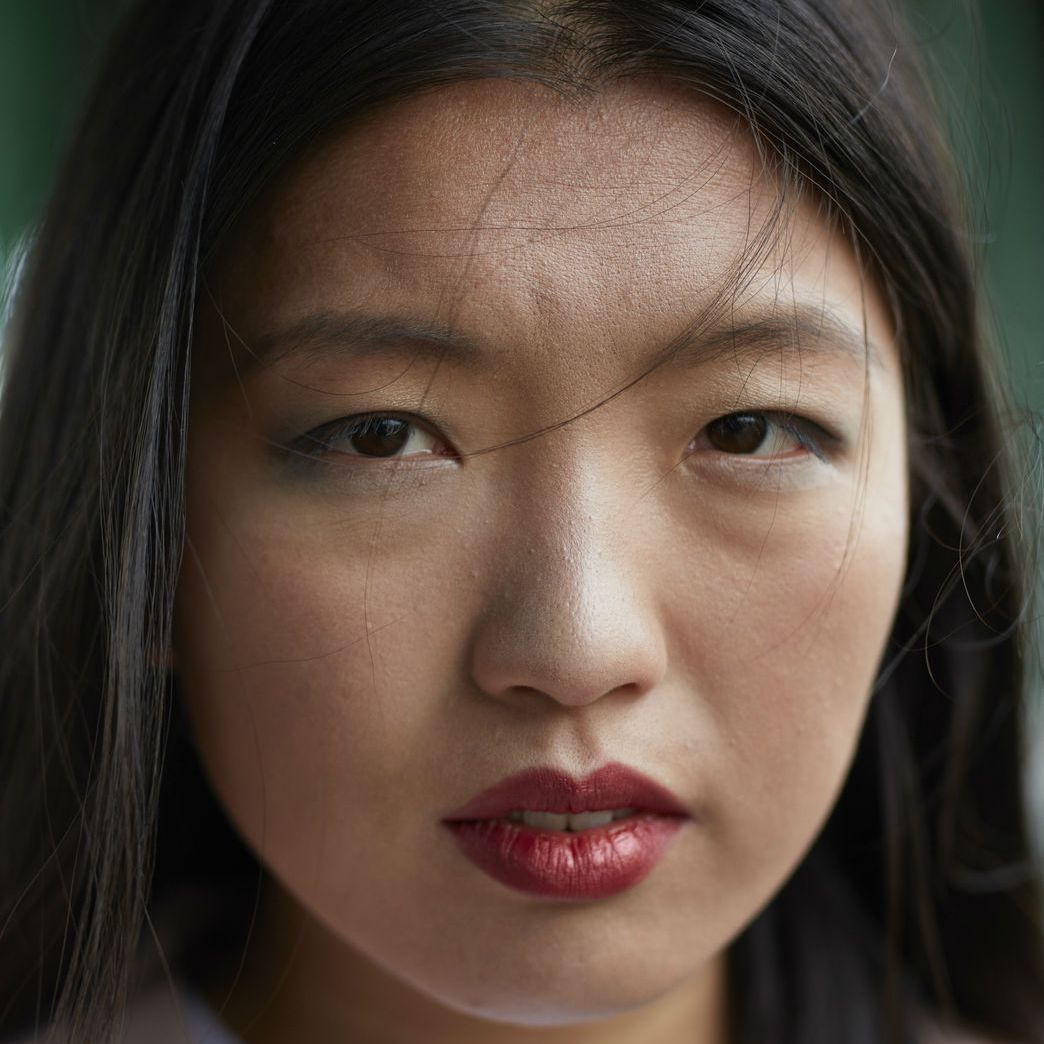 Young asian woman frowning