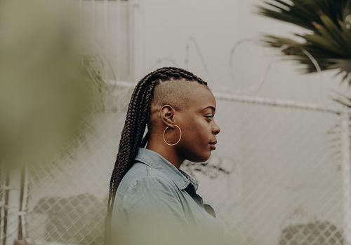 black woman with mohawk dread locs