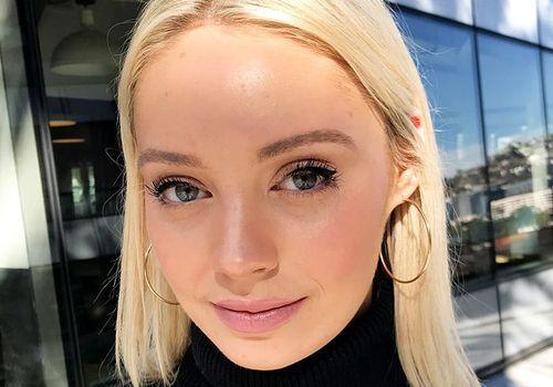 woman with blonde hair in hoop earrings