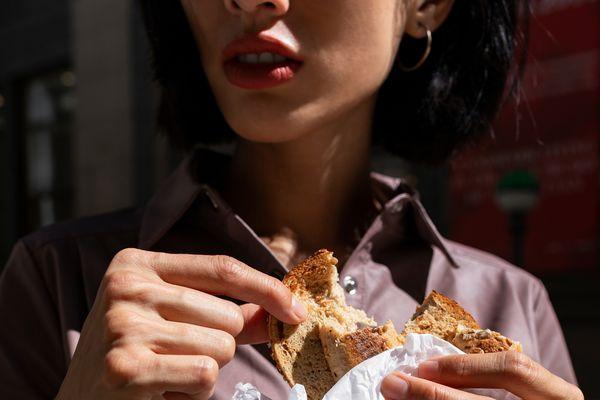 woman eating bagel
