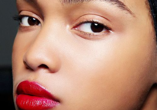 Woman wearing a bold red lip