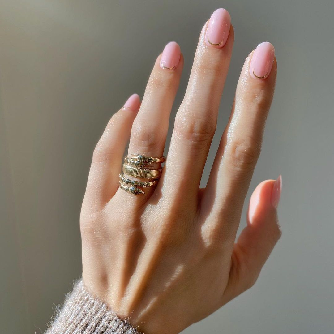 Person with milky pink nails.
