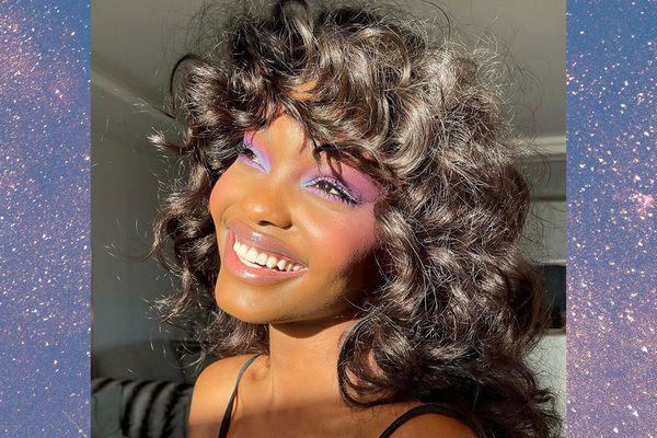 Smiling woman wearing colorful makeup