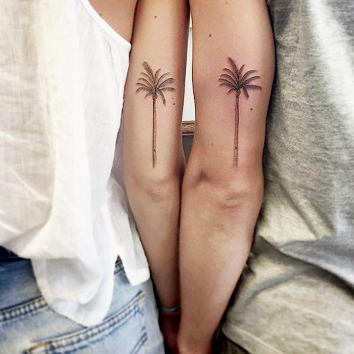 Matching palm tree tattoos