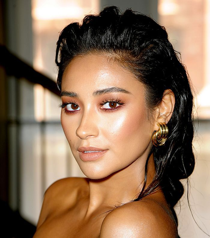 Shay Mitchell with her hair in a long wet braid