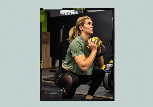 Woman performing a goblet squat at the gym.