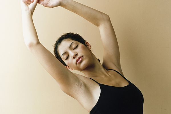 woman with arms in air