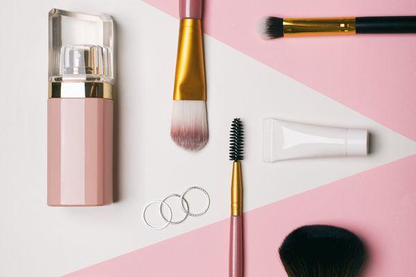 Eyeliner, makeup brush, perfume, face cream, face powder