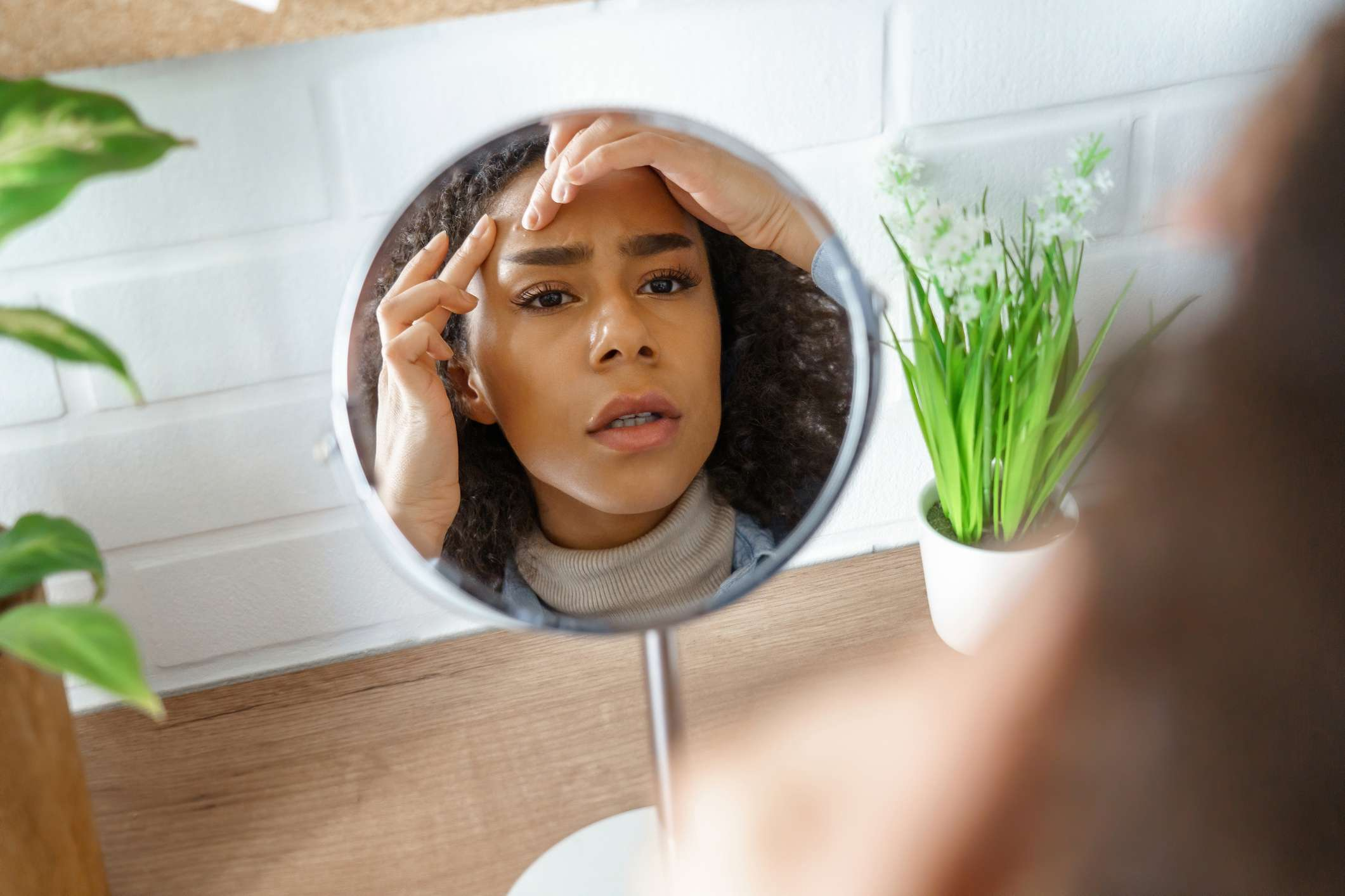 young mixed girl looking in the mirror