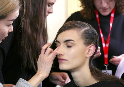 model getting makeup applied