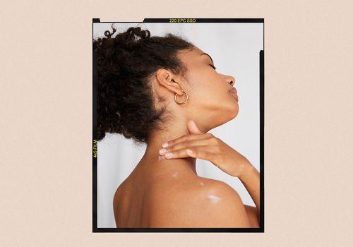 woman applying cream to neck