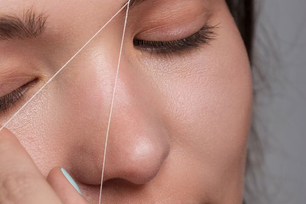 Close-up of woman getting her eyebrows threaded