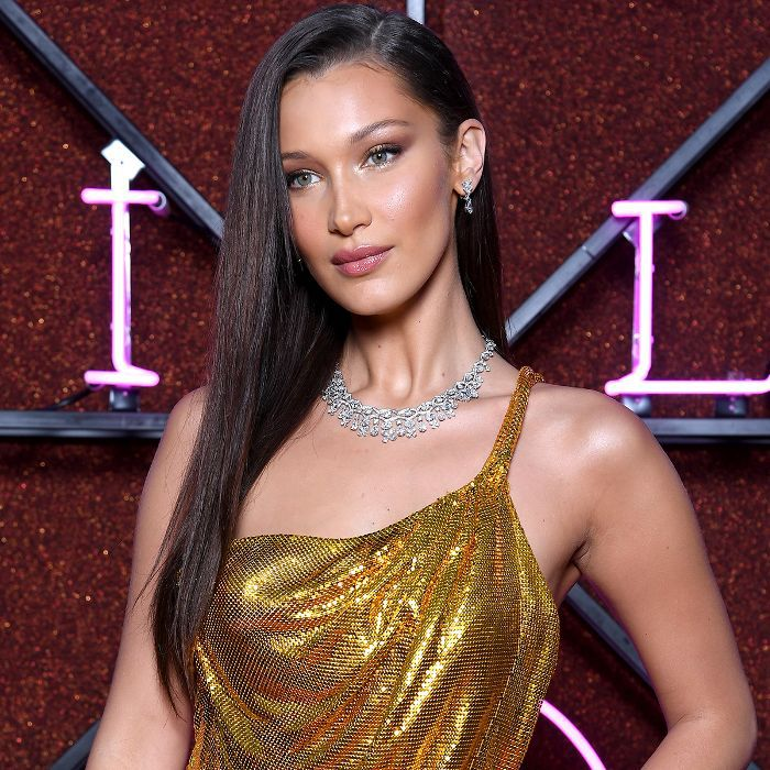 How to Find the Best Part for Your Face Shape 2014: Bella Hadid with gold dress and bold necklace