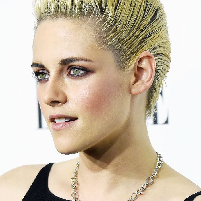 slicked-back hair: Kristen Stewart slicked back French twist