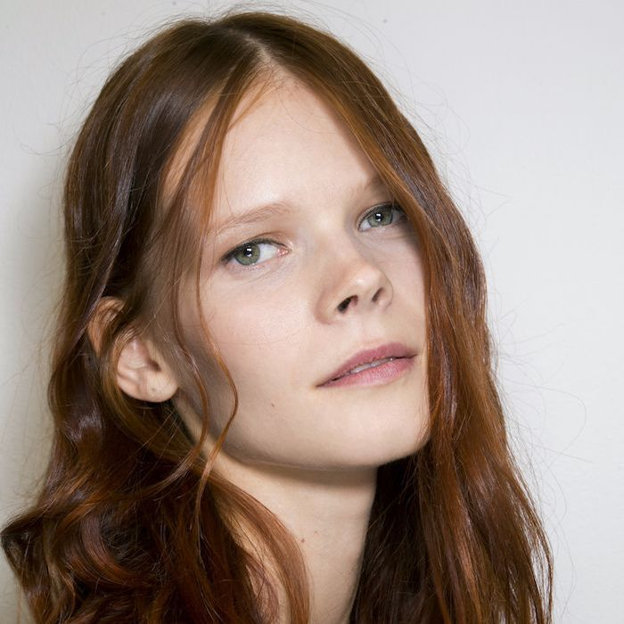 Model with auburn-colored hair