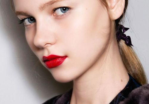 blonde girl with natural makeup and red lipstick