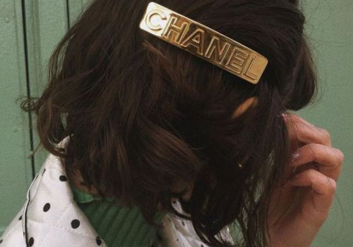 woman with gold chanel hair clip