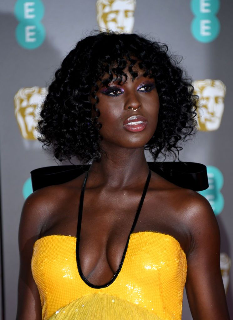 Jodie Turner-Smith curly bob with bangs