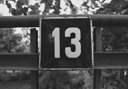Close-Up Of Number 13 On Railing
