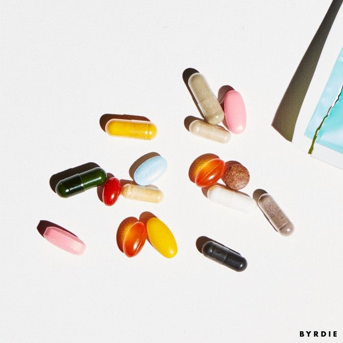 Colorful supplements spilled out of a packet