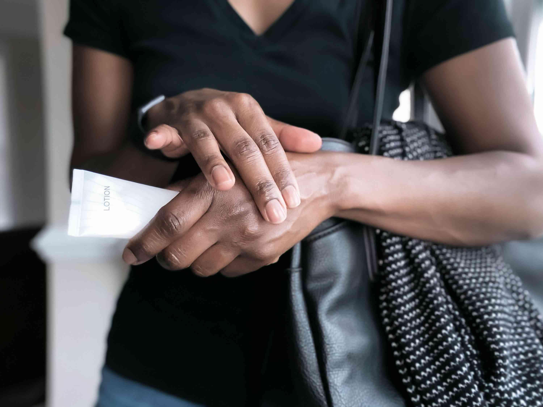Person applying hand cream.