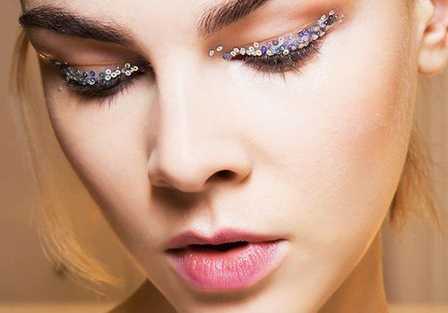 model with glitter eyeshadow looking down