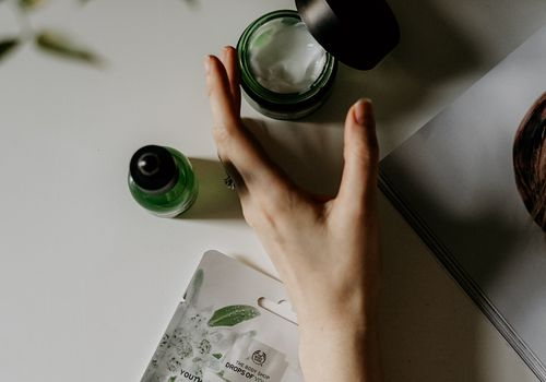Woman's hand with beauty products