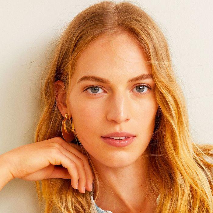 best brightening serum: woman with glowy skin