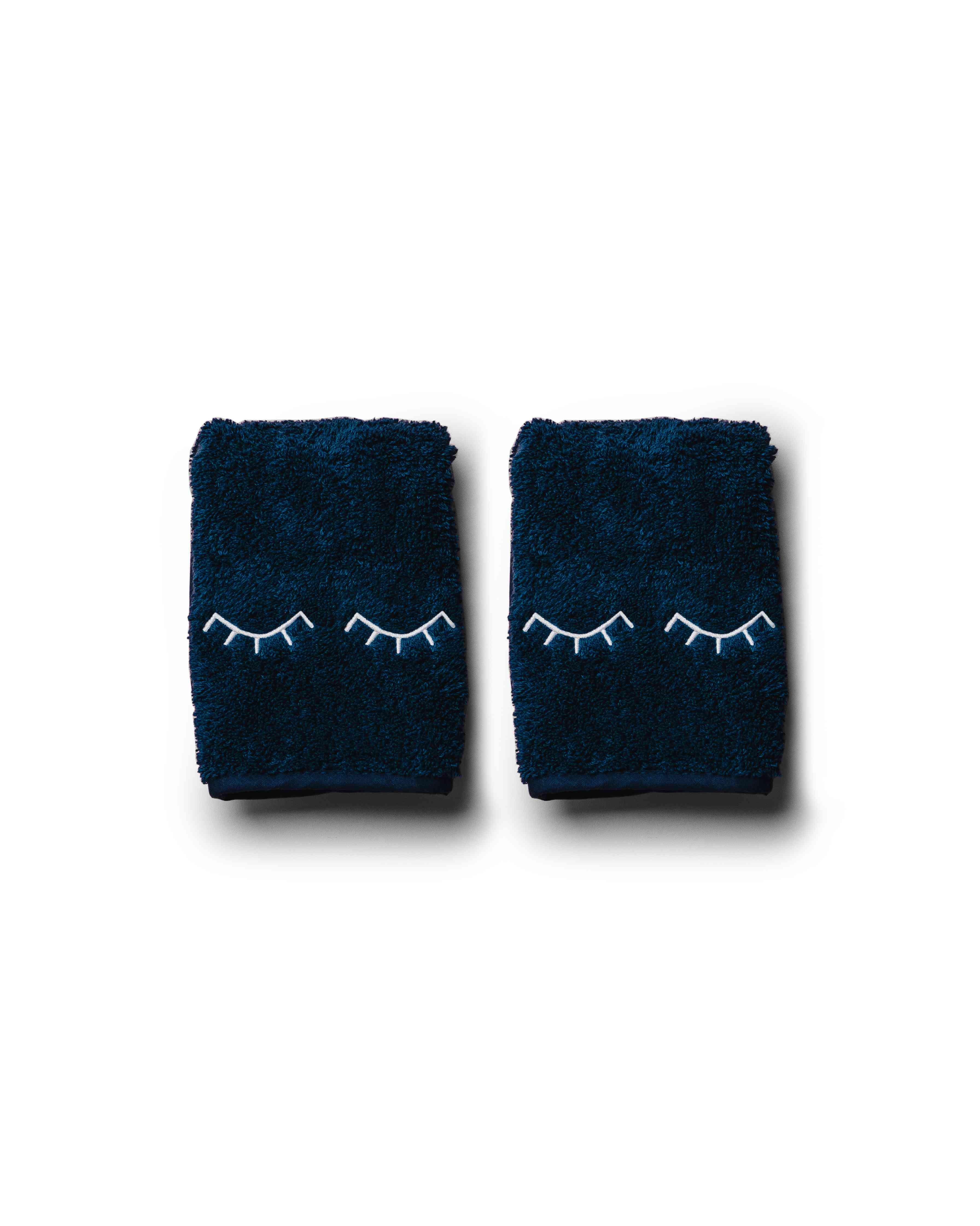 Towels with eyelashes on them